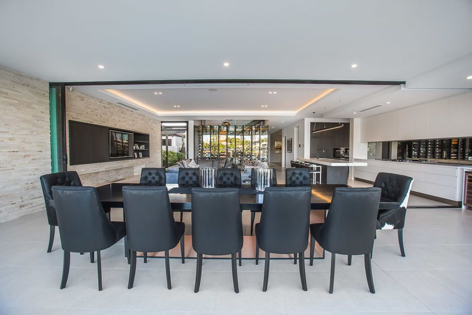 Mckelvey Homes   Modern Dining Room Also Bifold Door Dining Dining Tables Kitchen Leather Dining Chairs Modern Outdoor Entertaining Stone Walls
