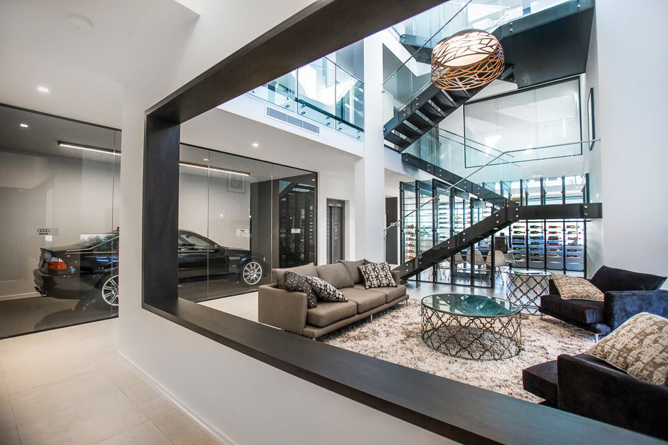 Mckelvey Homes   Modern Living Room  and Glass Balustrade Living Space Modern Open Living Pendant Lighting Stairs Wine Room