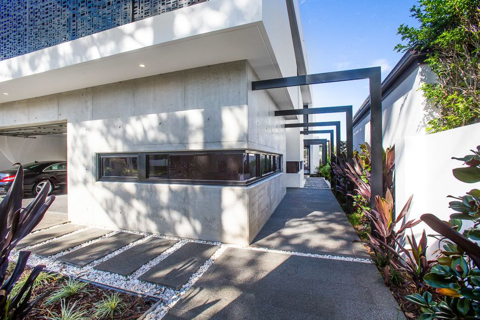 Mckelvey Homes with Modern Exterior  and Basalt Tiles Modern Outdoor Space Polished Concrete
