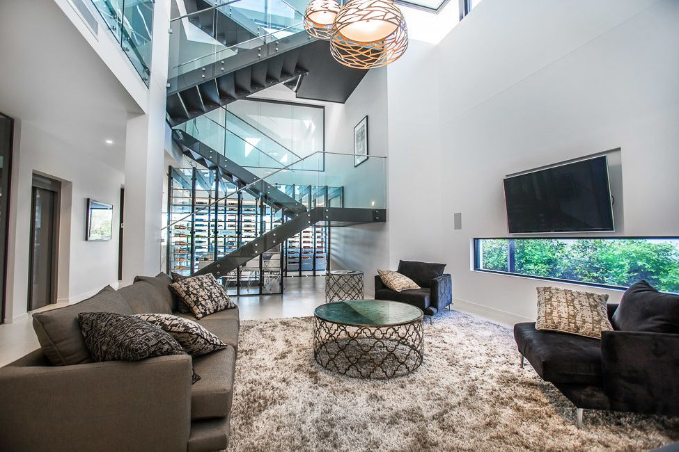 Mckelvey Homes with Modern Living Room  and Furniture Living Room Glass Balustrade Lift Modern Pendant Lighting Staircase Wine Room