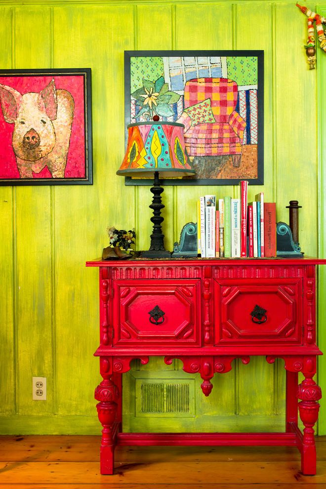 Mealey's Furniture Outlet   Farmhouse Hall Also Books Bright Green Wall Colorful Colorful Artwork Colorful Furniture Eclectic Artwork Eclectic Lampshade Red Console Table Red Side Table Rustic Wood Floor
