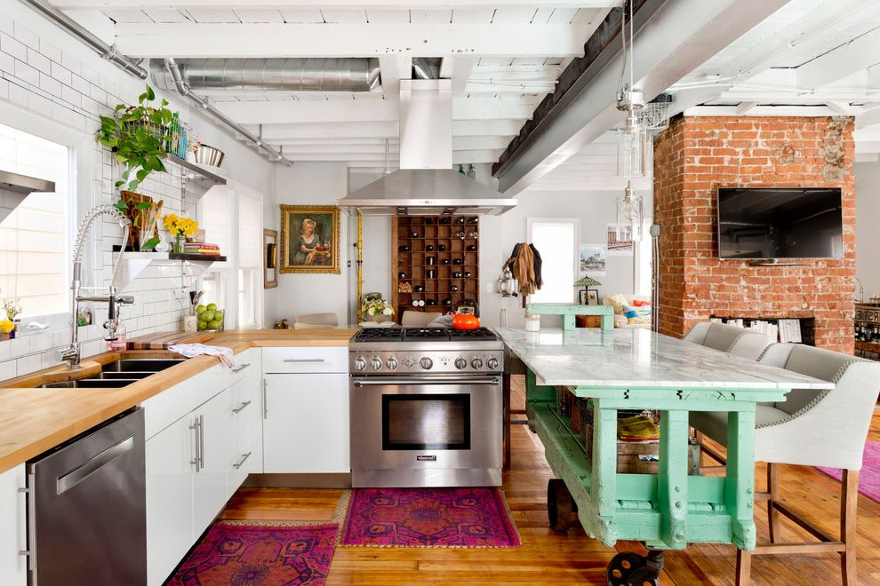 Media Cart on Wheels   Eclectic Kitchen  and Counter Stools Exposed Brick House Plants Rolling Kitchen Island Small Area Rug Vent Hood White Kitchen White Paneled Ceiling