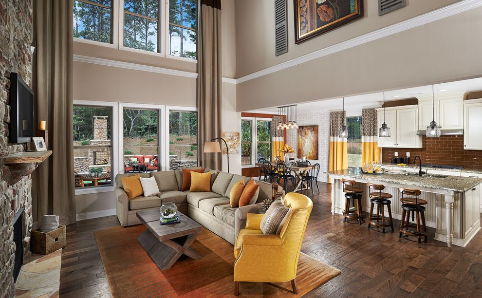 Meritage Homes Charlotte Nc with Traditional Living Room Also Area Rug Coffee Table Curtain Cushions Dining Area Fireplace Great Room Kitchen Leather Armchair Mantel Sofa Tall Ceiling Tv White Trim Windows Yellow and Orange Accents