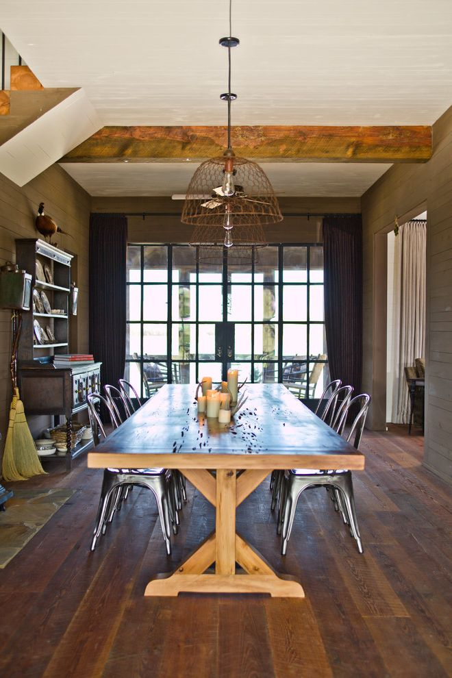 Metal Drafting Table   Farmhouse Dining Room Also Contemporary Exposed Beams Glass and Steel Doors Stone Hearth Trestle Table Updated Farmhouse Wide Plank Flooring
