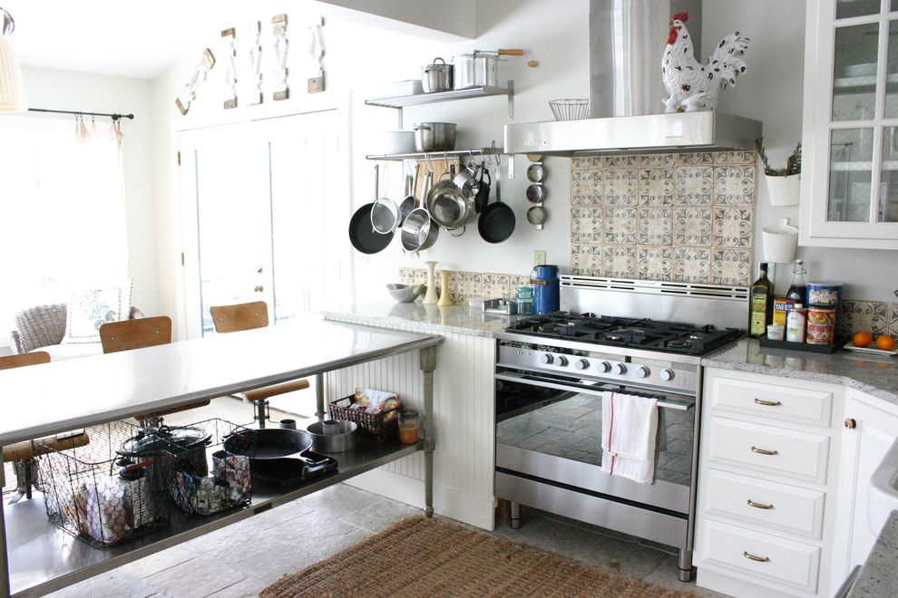 Metro Appliances Springdale with Eclectic Kitchen  and Beadboard Chicken Wire Glass Front Cabinets Jute Rug Pot Rack Stainless Steel Appliances Stainless Steel Table Tile Backsplash White Wire Baskets