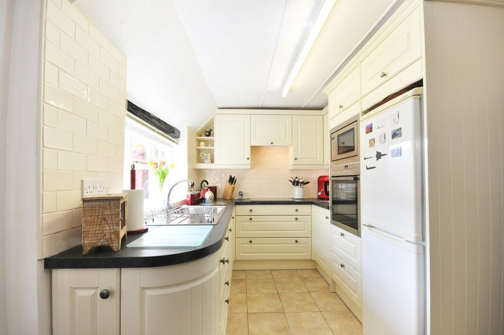 Metro Appliances Springdale with Farmhouse Kitchen  and Bespoke Units Black Worktop Built in Appliances Curved Unit Hide and Slide Knife Block Laminate Worktop Metro Tile Metro Tile Splashback Neff Oven Small Kitchen