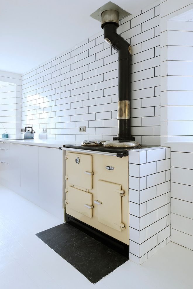 Metro Appliances Springdale with Scandinavian Kitchen  and Bright Cottage Cream Range Dark Grout Metro Tile Metro Tile Splashback Range Range Cooker Refurbishment White Countertop White Floors White Metro Tile