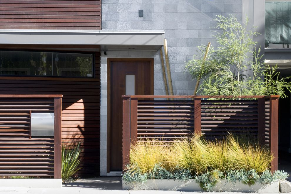 Metro Fence Company with Contemporary Entry  and Clerestory Front Door Geometric Geometry Minimal Neutral Colors Overhang Planter Boxes Planters Ribbon Windows Wood Fencing Wood Siding Wood Slat Fence