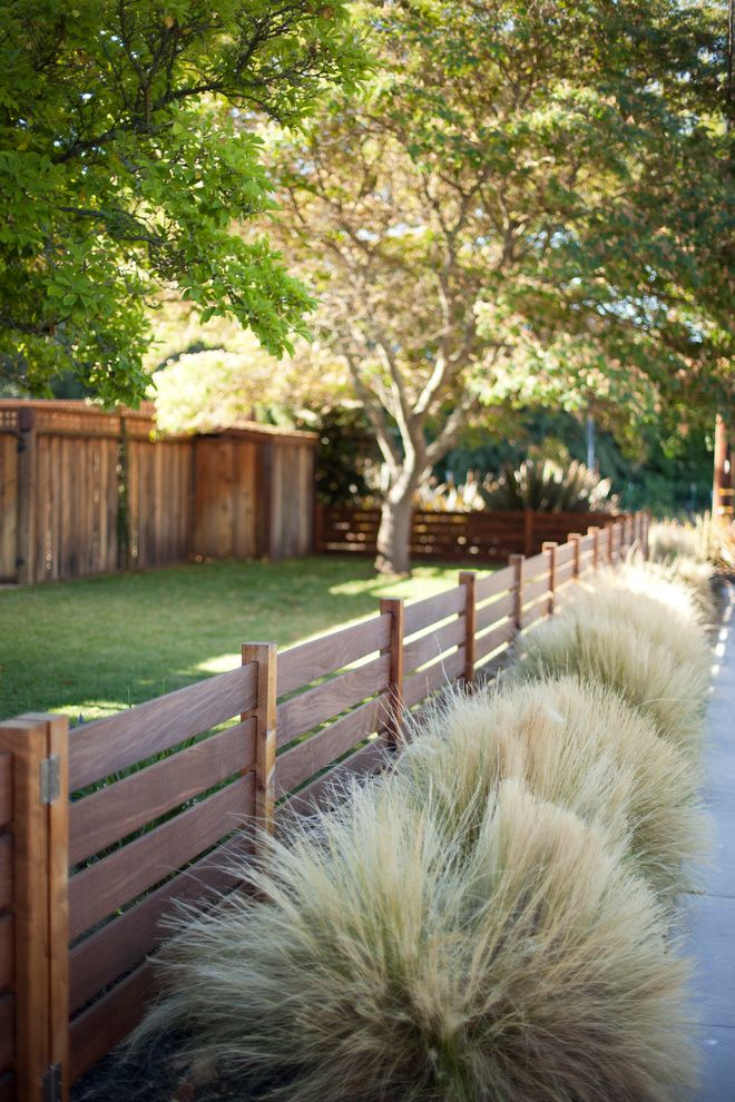 Metro Fence Company with Transitional Landscape  and Front Yard Grasses Mass Planting Narrow Planting Strip Wood Fence
