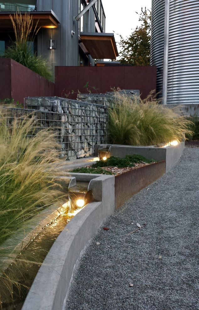Mexican Water Jug with Modern Landscape Also Cistern Corten Steel Gabion Wall Grasses Gravel Lighting Path Rill Water Feature