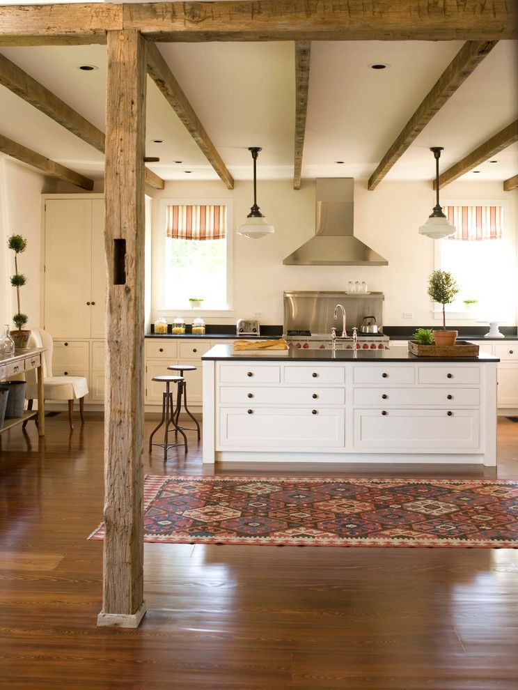 Michelle Kaufmann Architect   Farmhouse Kitchen Also Black Countertop Exposed Beams Farmhouse Kitchen Handhewn Beams Kilim Rug Metal Bar Stools Pendant Lights Slate Countertops