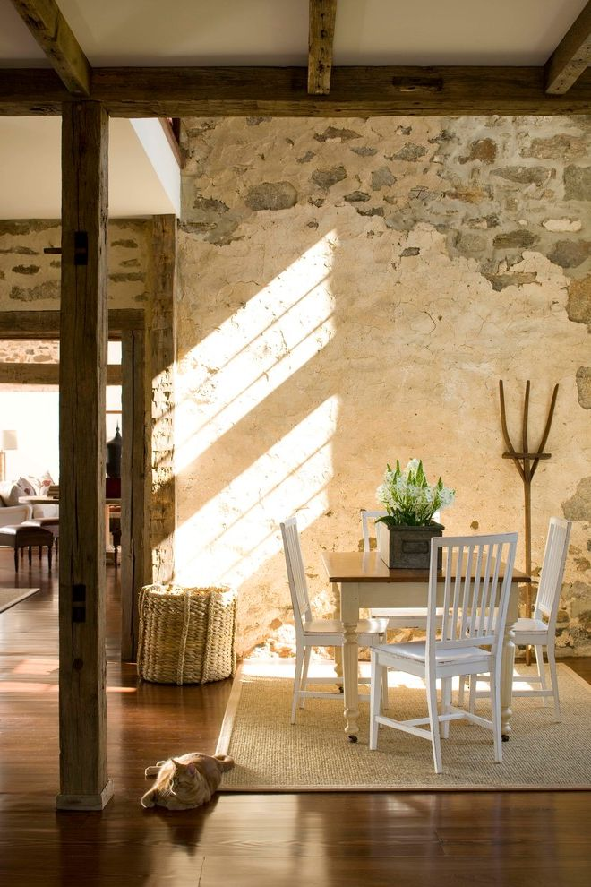 Michelle Kaufmann Architect with Farmhouse Dining Room Also Breakfast Area Handhewn Beams Interior Stone Natural Light Natural Stone Stone Wall White Dining Chairs