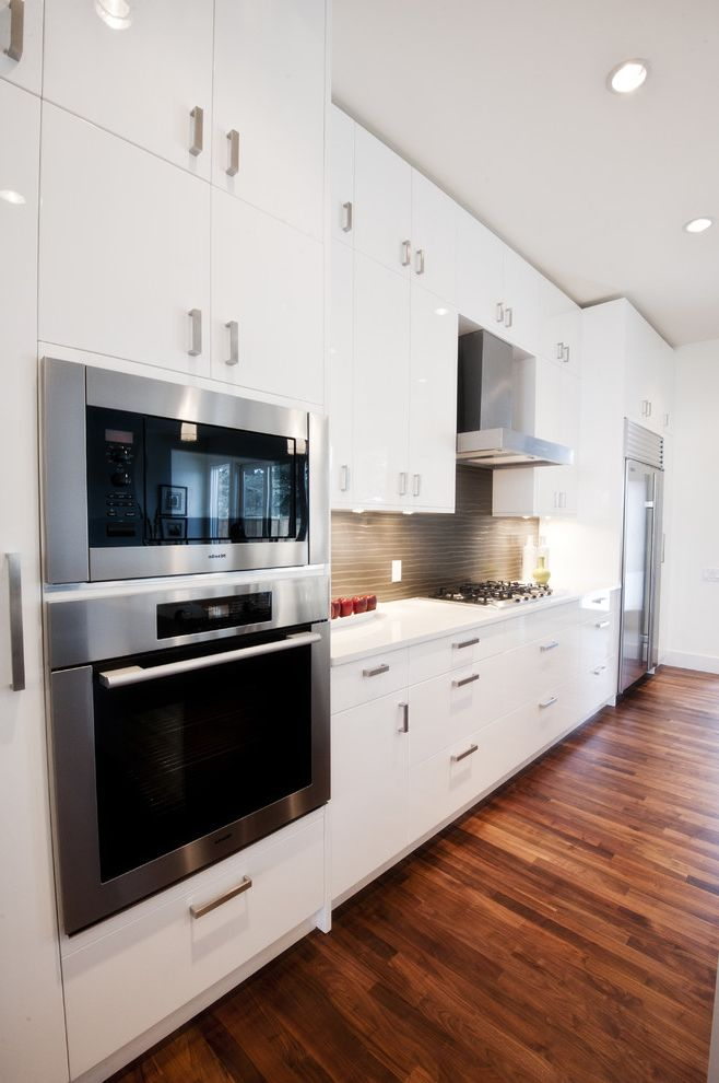 Microwave Toaster Combo   Contemporary Kitchen Also Brown Tiles Long Kitchen Modern Stainless Steel Stainless Steel Appliances Tiled Backsplash Tiles White Cabinets White Countertop White Countertop and White Cabinets Wood Floor