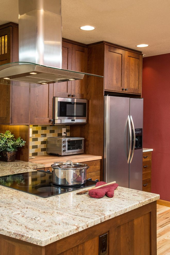 Microwave Toaster Combo with Craftsman Kitchen  and Butcher Block Countertop Multicolor Backsplash Range Hood Red Wall Stainless Steel Appliances Toaster Oven White Cabinets White Drawers Yellow Tile Backsplash
