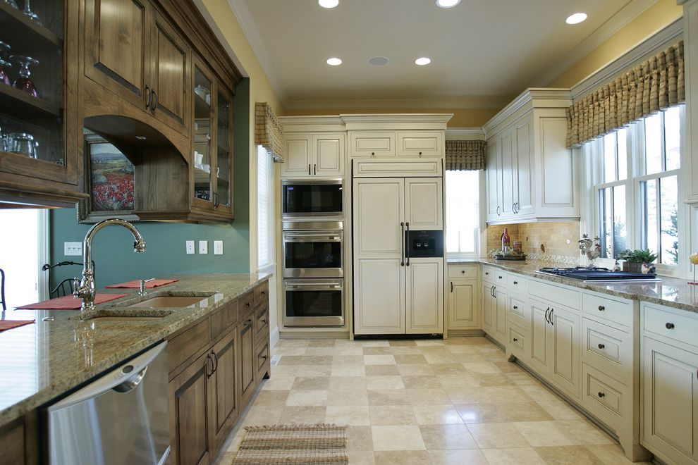 Microwave Toaster Combo with Traditional Kitchen  and Dark Stained Wood Cabinets Frame and Panel Glass Front Cabinets Integrated Kitchen Stainless Steel Tile Back Splash Tile Floor Valance