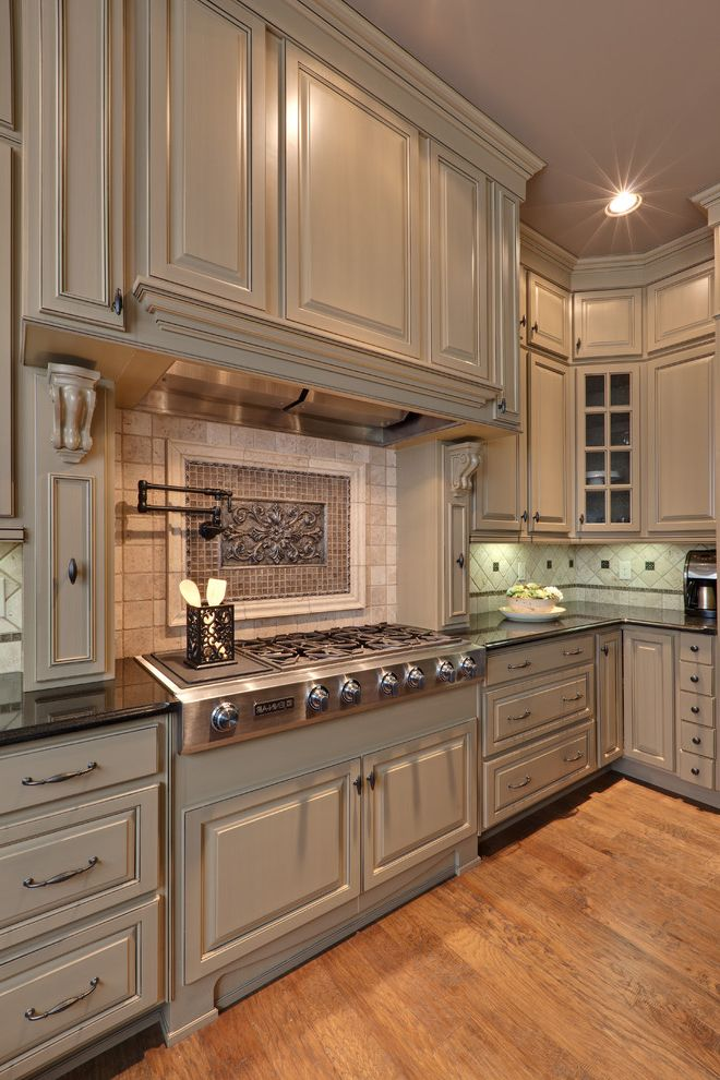 Mid America Cabinets with Traditional Kitchen and Ceiling Lighting Kitchen Hardware Neutral Colors Painted Ceiling Pot Filler Range Hood Recessed Lighting Tile Backsplash Under Cabinet Lighting Wood Cabinets Wood Flooring