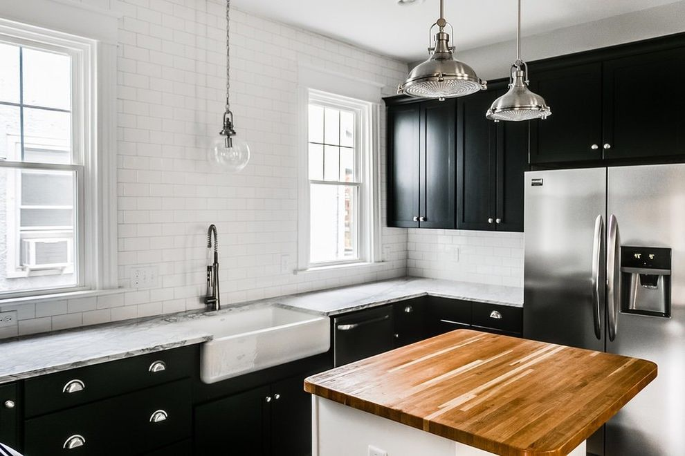 Midsouth Appliances with Shabby Chic Style Spaces and Apron Sink Bath Vanity Chimney Hood Exposed Brick Farm Sink House Flip Industrial Marble Countertops Painted Cabinets Shabby Chic Shaker Stainless Appliances Wood Countertop