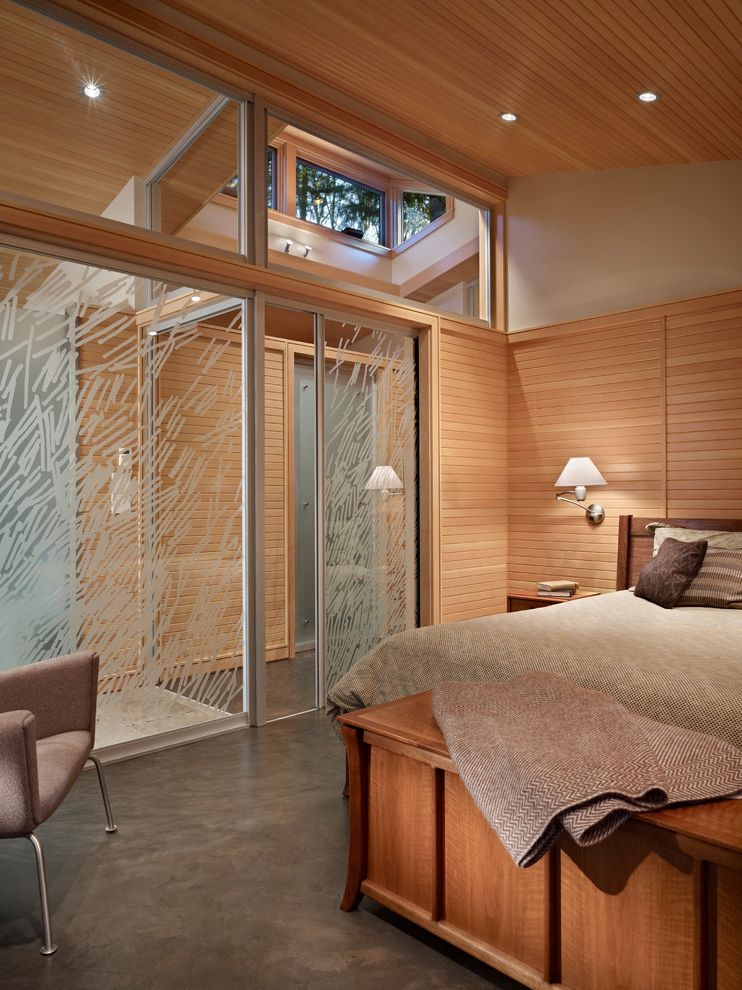 Mile North Hotel Chicago with Midcentury Bedroom  and Decorated Glass Decorated Glass Pocket Door Frosted Glass Slanted Ceiling Sliding Glass Door Textured Floor Wall Sconce Wegner Armchair Window Wall Wood Panel Ceiling Wood Panel Wall