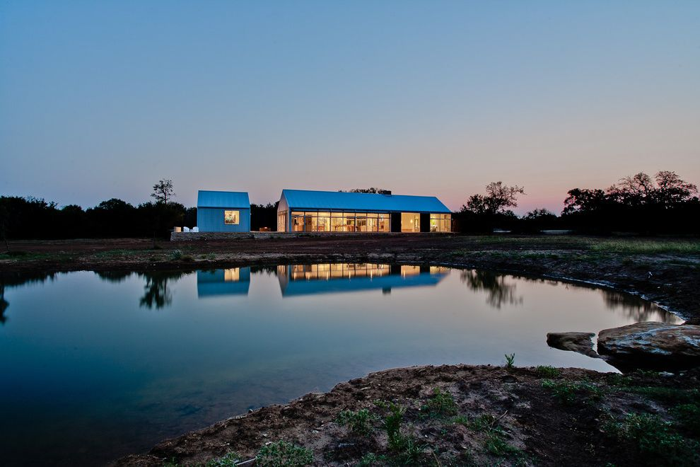 Mile North Hotel   Contemporary Exterior  and Barn Gable Roof Glass Walls Metal Roof Minimal Pond Rural Single Story Studio