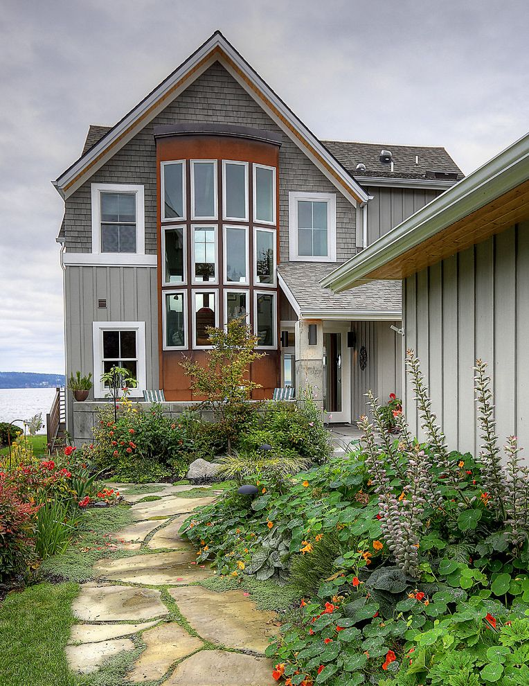 Mile North Hotel with Beach Style Exterior  and Bay Window Beachfront Covered Entry Gray Board and Batten Gray Shingle Siding Shingle Roof Stone Pathway Stone Walkway Waterfront Wood Siding