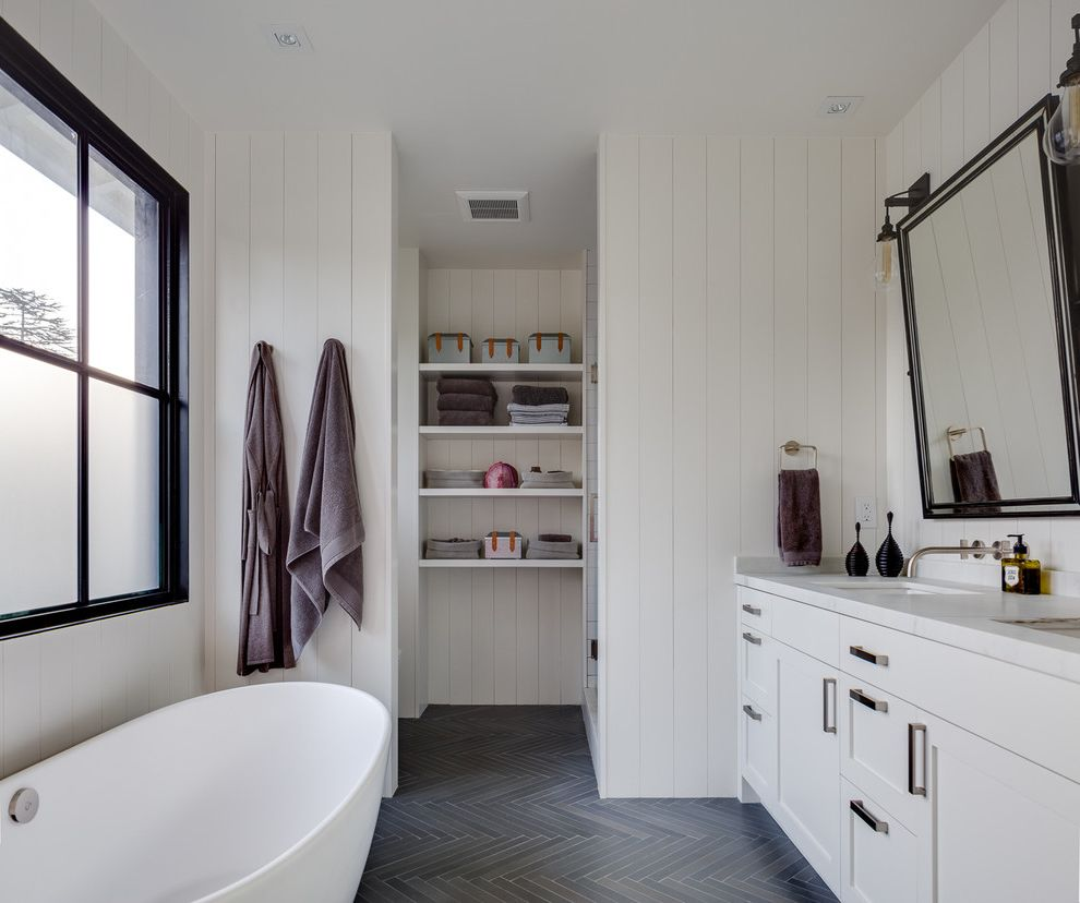 Mill Valley Spa   Transitional Bathroom  and Bath Towels Black and White Black Window Trim Herringbone Open Shelves Spa Bath Tilted Mirror Towel Ring Wall Mounted Faucet Wall Sconces White Paneled Walls
