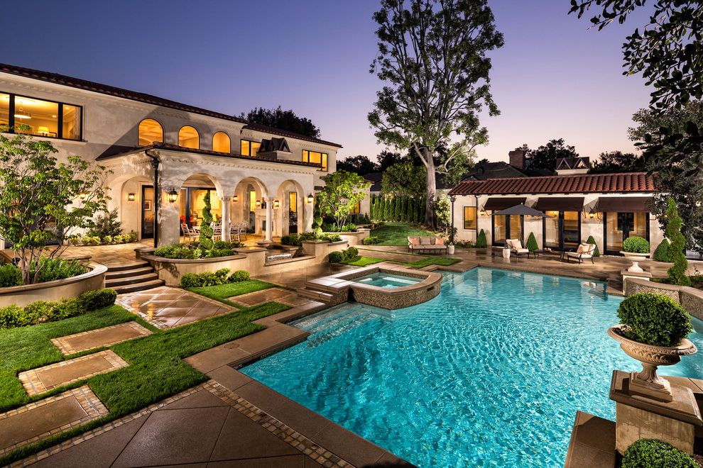 Mill Valley Spa with Mediterranean Pool  and Arched Windows Archways Covered Patio Landscaping Outdoor Furniture Outdoor Lighting Pool Lights Raised Planters Stepping Stones White Columns