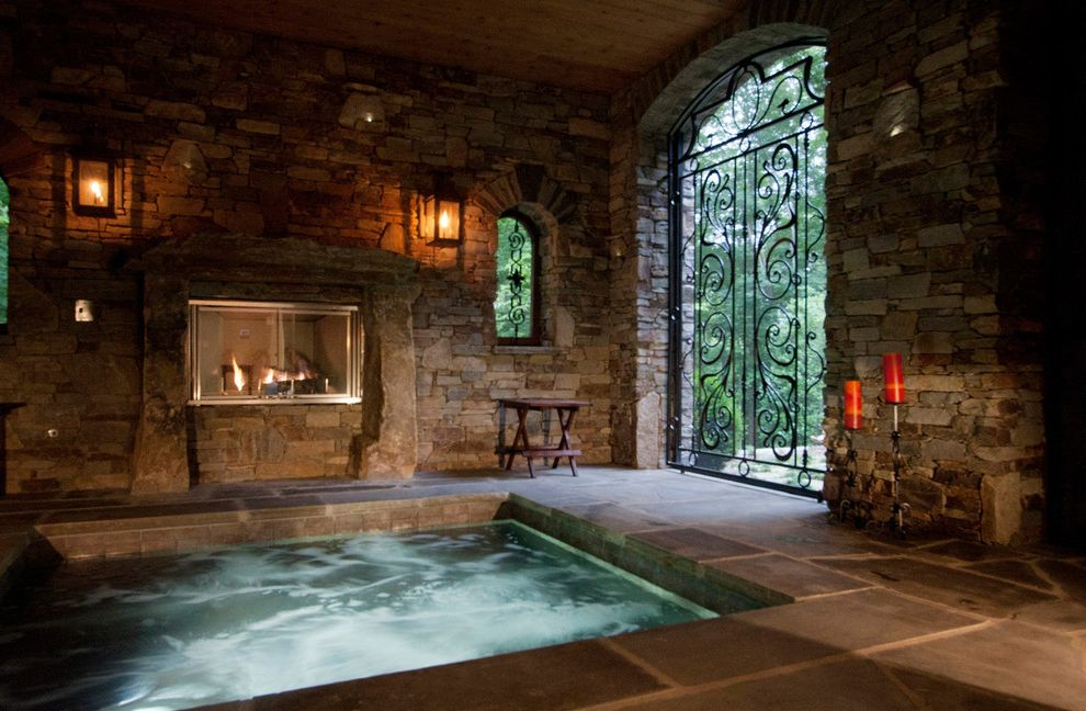 Mill Valley Spa with Traditional Pool  and Aquatic Archway Covered Hot Tub Iron Gate Spa Stacked Stone Stone Fireplace Stone Tile Floor Water Feature