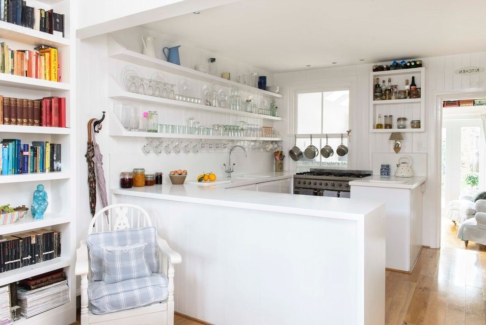 Missing Piece Tampa with Beach Style Kitchen  and Airy Bright Charming Coastal Cottage Coastal Decor Coastal Home Color Coordinated Books Kitchen Shelves Light Open Open Shelving Seaside White Countertop White Kitchen White Worktop