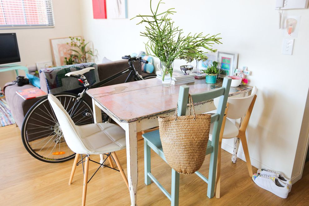Missing Piece Tampa with Eclectic Dining Room  and Bike Distressed Wood Miss Matched Chairs Pink Table Top
