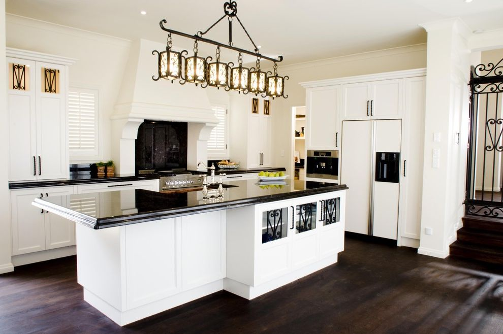 Mission Style Light Fixtures with Mediterranean Kitchen and Dark Wood Floors Hood Iron Lantern Lights Oven Surround Shutters Spanish White and Black White Cabinets