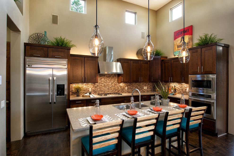 Mission Style Pendant Lighting   Transitional Kitchen Also Breakfast Bar Clerestory Windows Dark Wood Floors Eat in Kitchen Glass Pendant Light