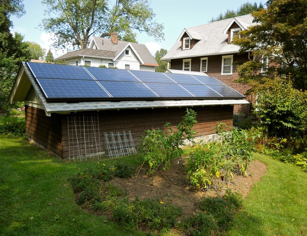 Missoula Electric Coop   Traditional Shed  and Electric Energy Gable Roof Grass Landscape Design Photovoltaic Renewable Shingles Solar Roof Sustainable Trellis