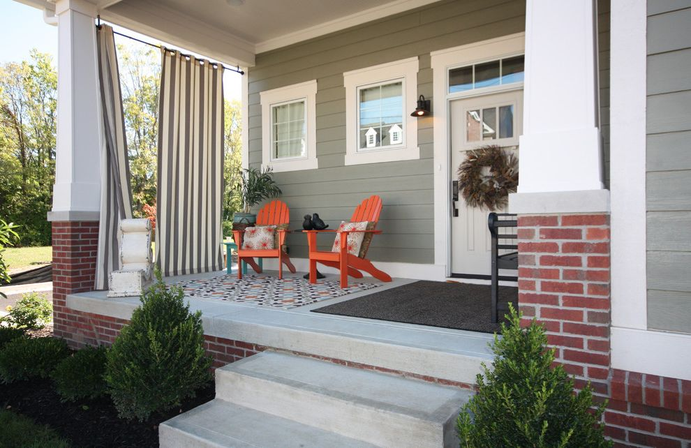 Mobile Home Porch Kits with Craftsman Porch and Adirondack Chairs Area Rug Brick Covered Patio Front Porch Gray Siding Outdoor Sconce Steps Striped Curtain Tapered Columns Transom Window White Door White Window Trim Windows Wreath