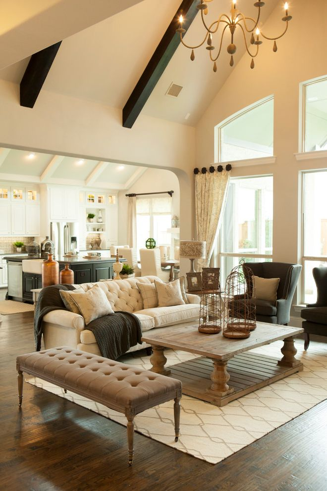 Model Homes Near Me   Traditional Living Room Also Beige Sofa Cathedral Ceiling Ceiling Beams Chandelier Rectangular Coffee Table Tufted Bench White Area Rug