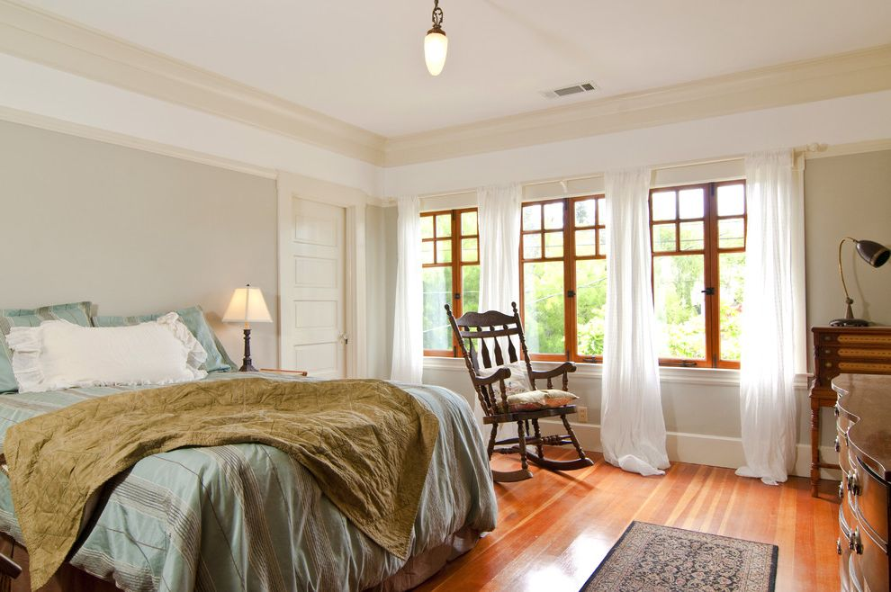 Monarch Specialities with Craftsman Bedroom Also Baseboards Casement Windows Crown Molding Curtains Drapes Gray Walls Green Bedding Panel Door Rocker Rocking Chair Striped Bedding Window Treatments Wood Flooring