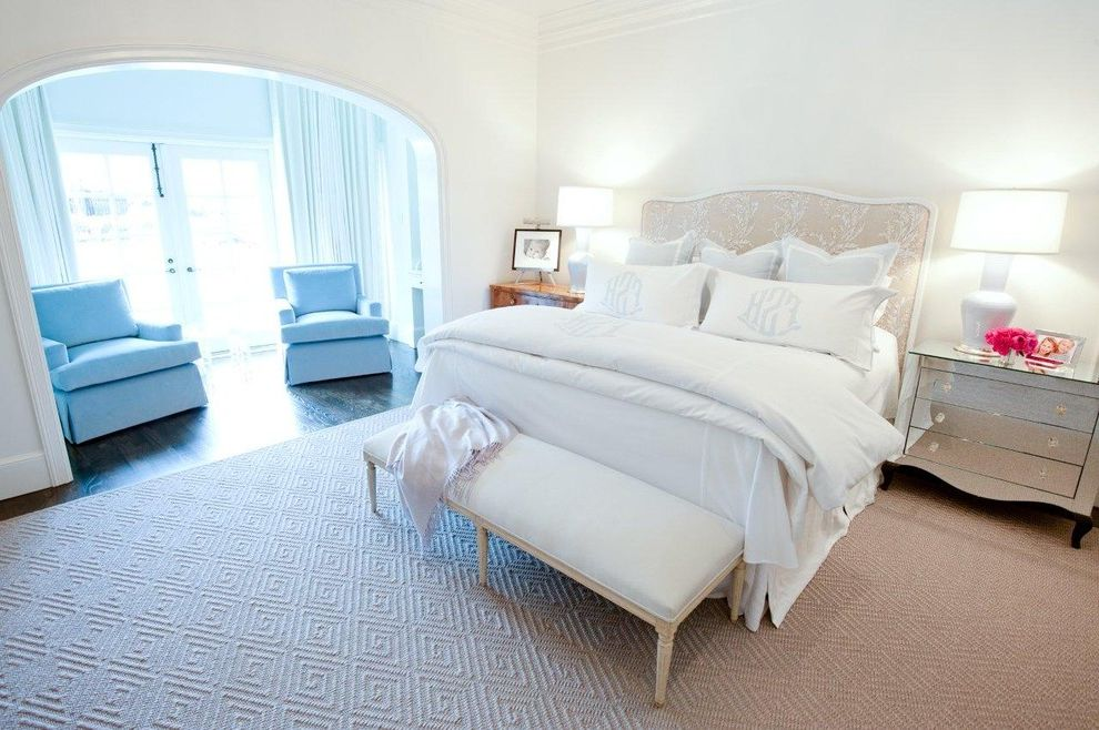 Monogram Area Rug   Transitional Bedroom  and Archway Area Rug Baseboards Crown Molding Foot of the Bed Mirrored Chest Mirrored Furniture Monogram Sitting Area Upholstered Bench Upholstered Headboard White Bedding White Wood Wood Molding