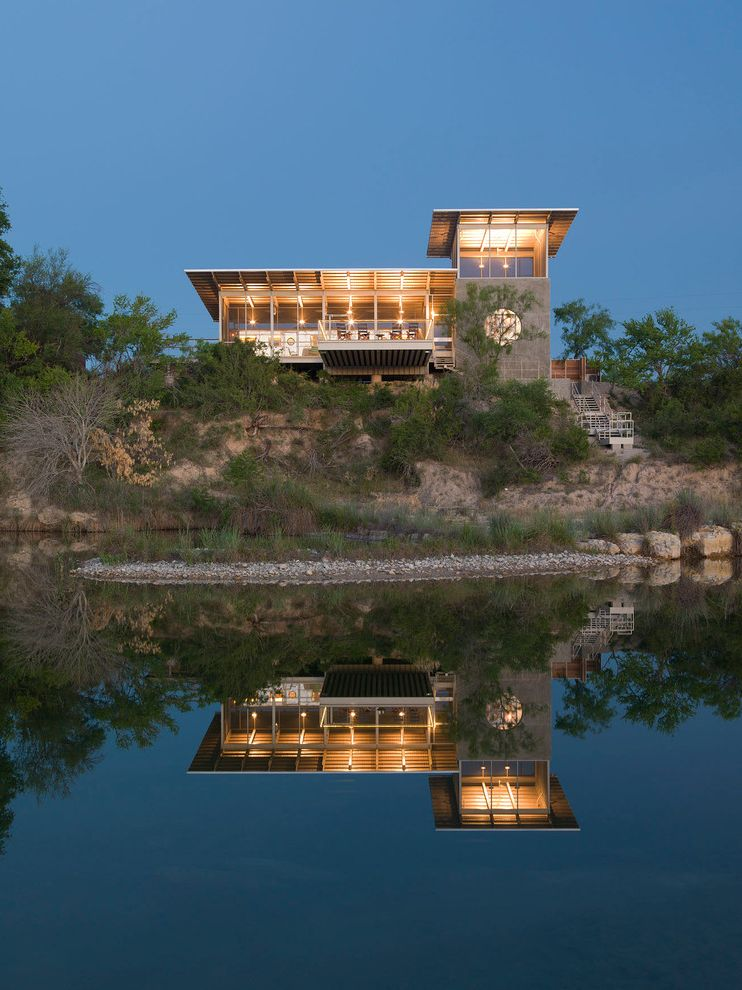 Moon Tower Austin with Contemporary Exterior and Deck Eaves Hillside Lake Large Windows Mirror Reflection Natural Landscape Overhang Rafter Tails Tower