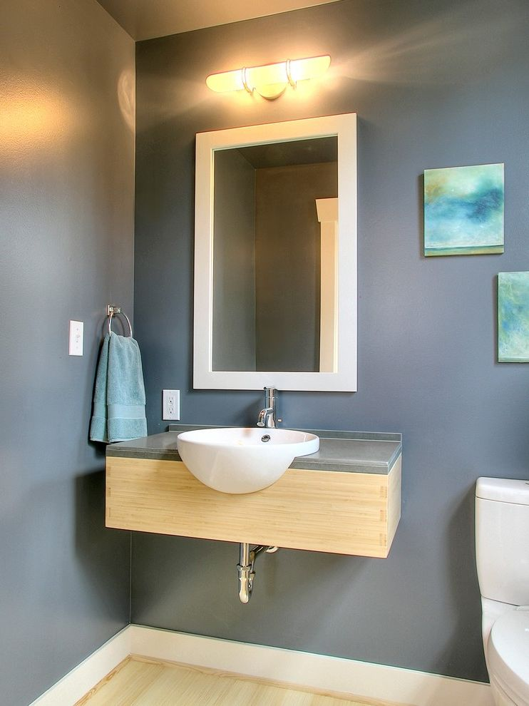 Moore Plumbing Supply   Traditional Powder Room  and Art Baseboard Blonde Wood Blue Floating Sink Light Fixture Paintings Slate Blue Small Towel Ring Vessel