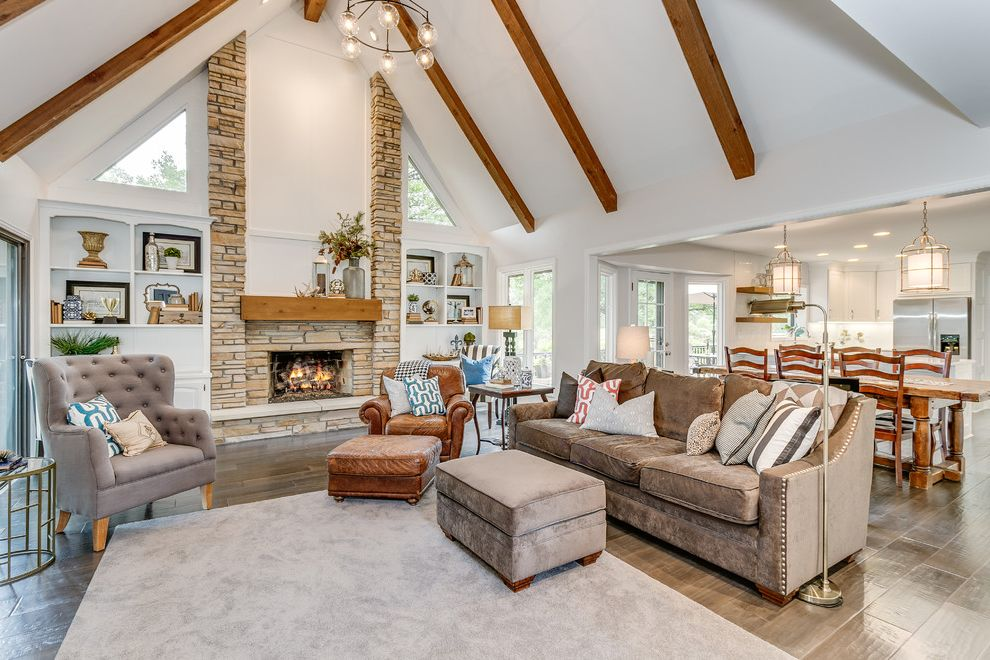 Mor Furniture Tacoma   Farmhouse Living Room  and Brown Sofa Built in Cabinets Clerestory Windows Gray Area Rug Stacked Stone Vaulted Ceiling Wood Beams