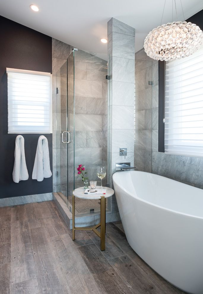 Morrison Plumbing Supply with Transitional Bathroom  and Dark Grey Wall Marble Brass Side Table Marble Glass Shower Marble Paved Wall Modern White Bath Tub Thin White Window Shades Translucent Round Bubble Hanging Light Fixture