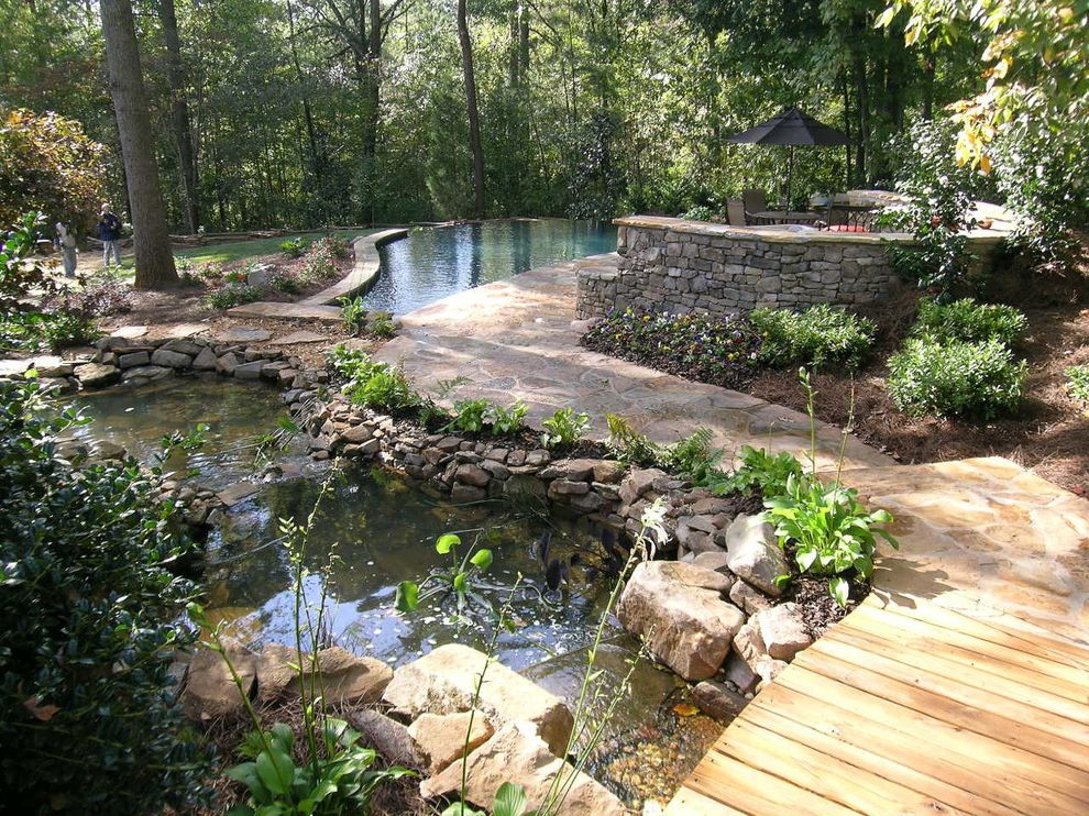 Mosquito Spray for Yards   Traditional Landscape Also Arched Bridge Black Umbrella Boulders Curved Wall Flagstone Walkway Patio Pond Pool Stacked Stone Vanishing Edge Pool Waterfall