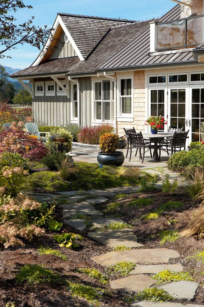 Moss and Associates with Traditional Landscape Also Berms Container Plants French Doors Metal Roof Outdoor Dining Path Patio Doors Patio Furniture Pavers Potted Plants Shake Roof Shingle Siding Stone Pathway Stone Patio Walkway