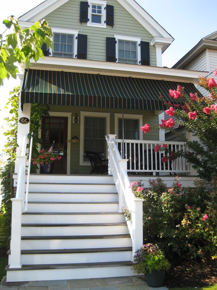 Moss and Associates with Victorian Exterior Also Awning Blue Stone Walk Covered Porch Crepe Myrtle Entrance Entry Front Porch House Numbers Lap Siding Pink Flowers Roses Shutters White Trim Window Shutters Wood Siding