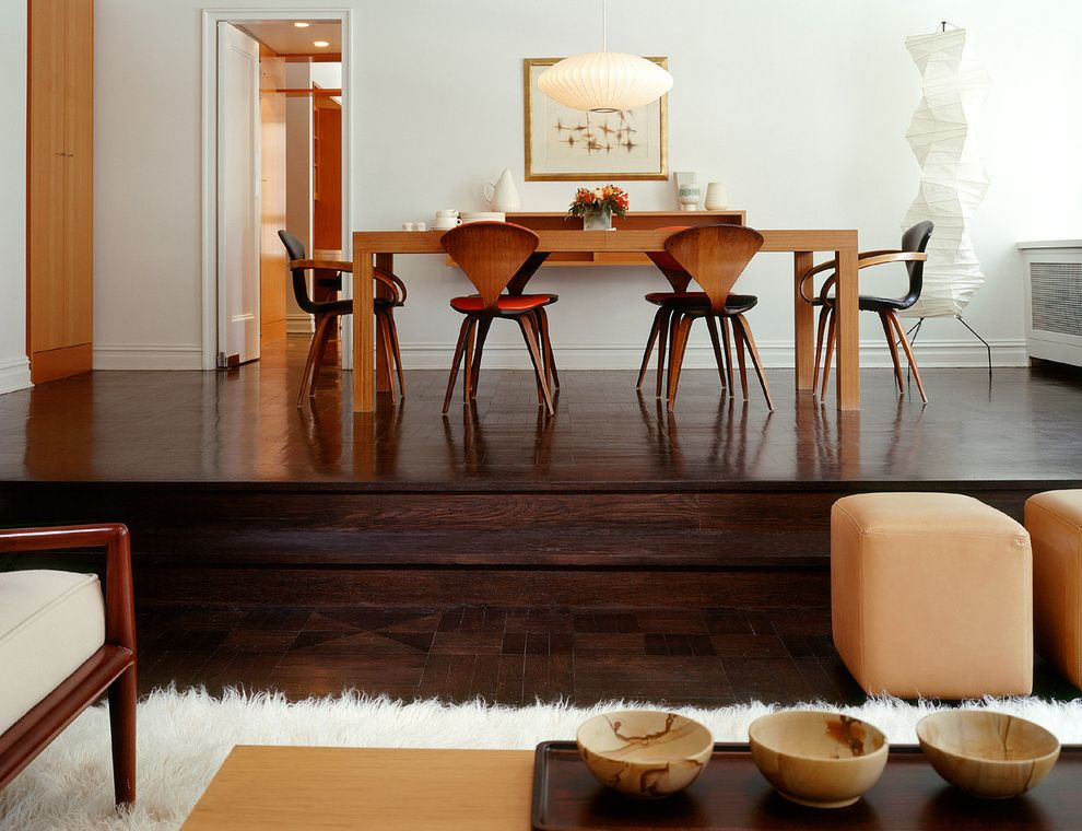 Most Expensive Wood Flooring   Contemporary Dining Room  and Armchair Cherner Dark Stained Floor Flokati Lamp Light Modern Natural Nelson Paper Lantern Raised Floor Side Sidechair Step Steps Sunken Living Turned Bowls Two Level White Wood Dining Table