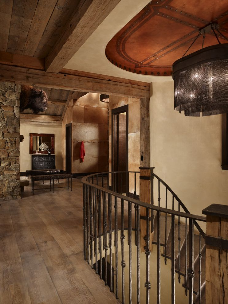 Most Expensive Wood Flooring   Rustic Staircase Also Chandelier Iron Railing Mountain Home Rustic Rustic Wood Floor Stone Wood Beams Wood Ceiling Wood Floor