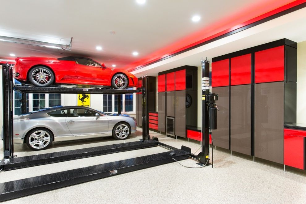 Motorized Garage Storage Lift   Contemporary Garage  and Brown Cabinets Built in Cabinets Car Lift Custom Garage Garage Cabinets Garage Storage High Gloss Cabinets Led Lighting Metal Laminate Red Accents Red Cabinets Red Car Silver Car