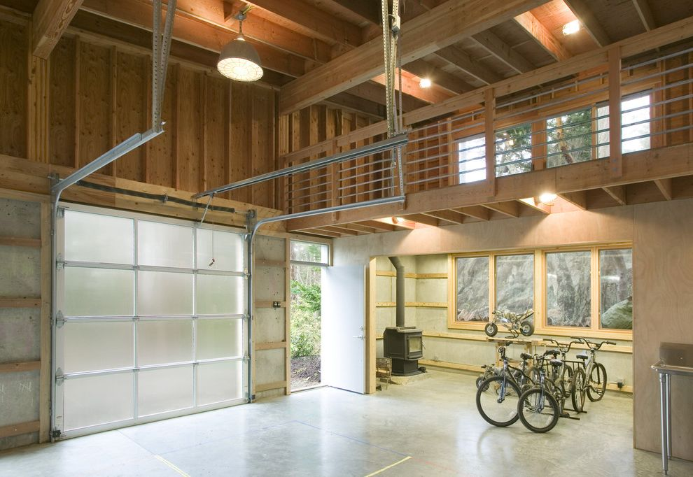 Motorized Garage Storage Lift   Modern Garage Also Balcony Bike Rack Exposed Beams Exposed Studs Industrial Pendant Large Pendant Polished Concrete Floor Rafters Sink Stand Stove Pipe Translucent Garage Doors Wood Stove