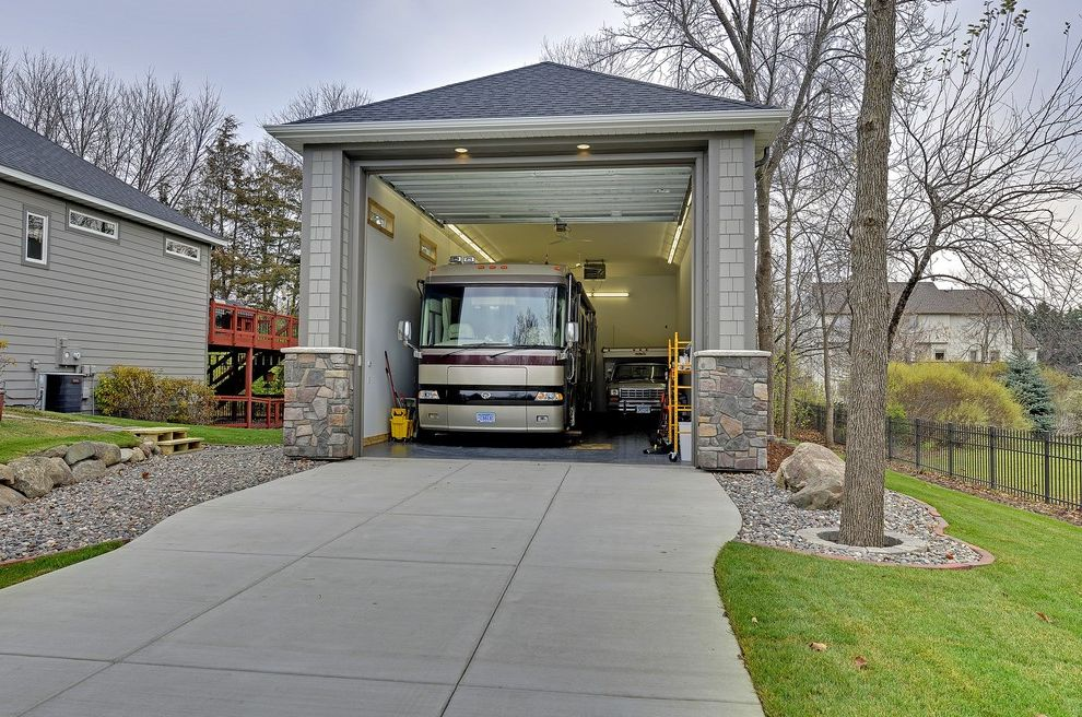 Motorized Garage Storage Lift   Traditional Garage  and 4th Garage Custom Made Dream Garage Garage Gray Siding High Ceiling Large Garage Mobile Home Rv Storage