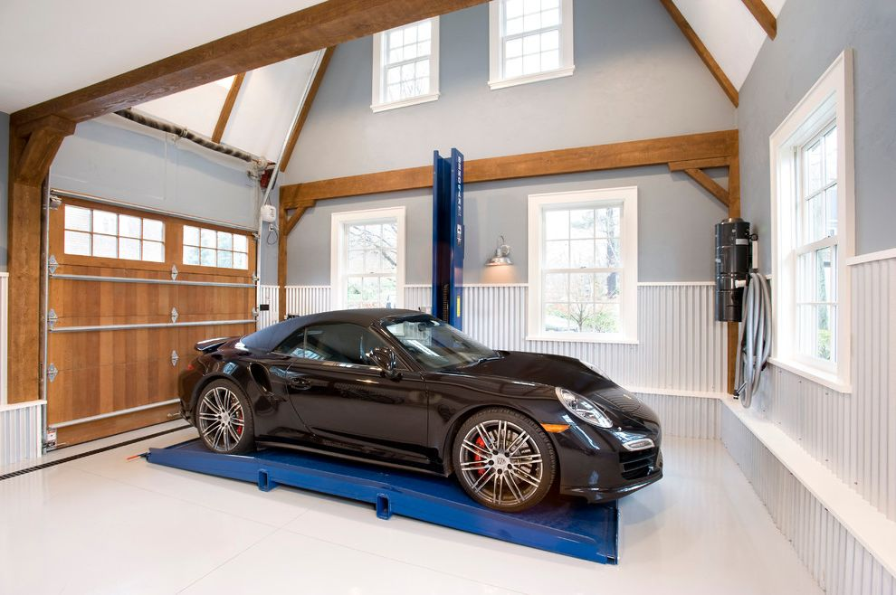 Motorized Garage Storage Lift with Rustic Garage  and Car Lift Clerestory Windows Corrugated Metal High Ceiling