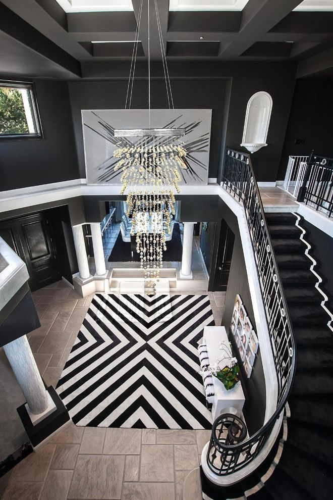 Movement Mortgage Reviews   Contemporary Entry  and Black and White Black Carpet Chandelier Chevron Rug Contemporary Contemporary Artwork Dramatic Dramatic Design Entry Rug Kardashian Modern Modern Artwork Pillars Staircase Tile Floor White Tiles